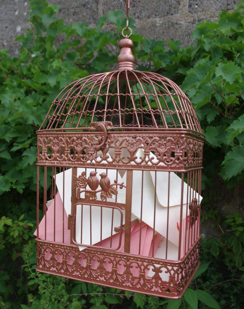 Cage à oiseaux livre d'or/urne