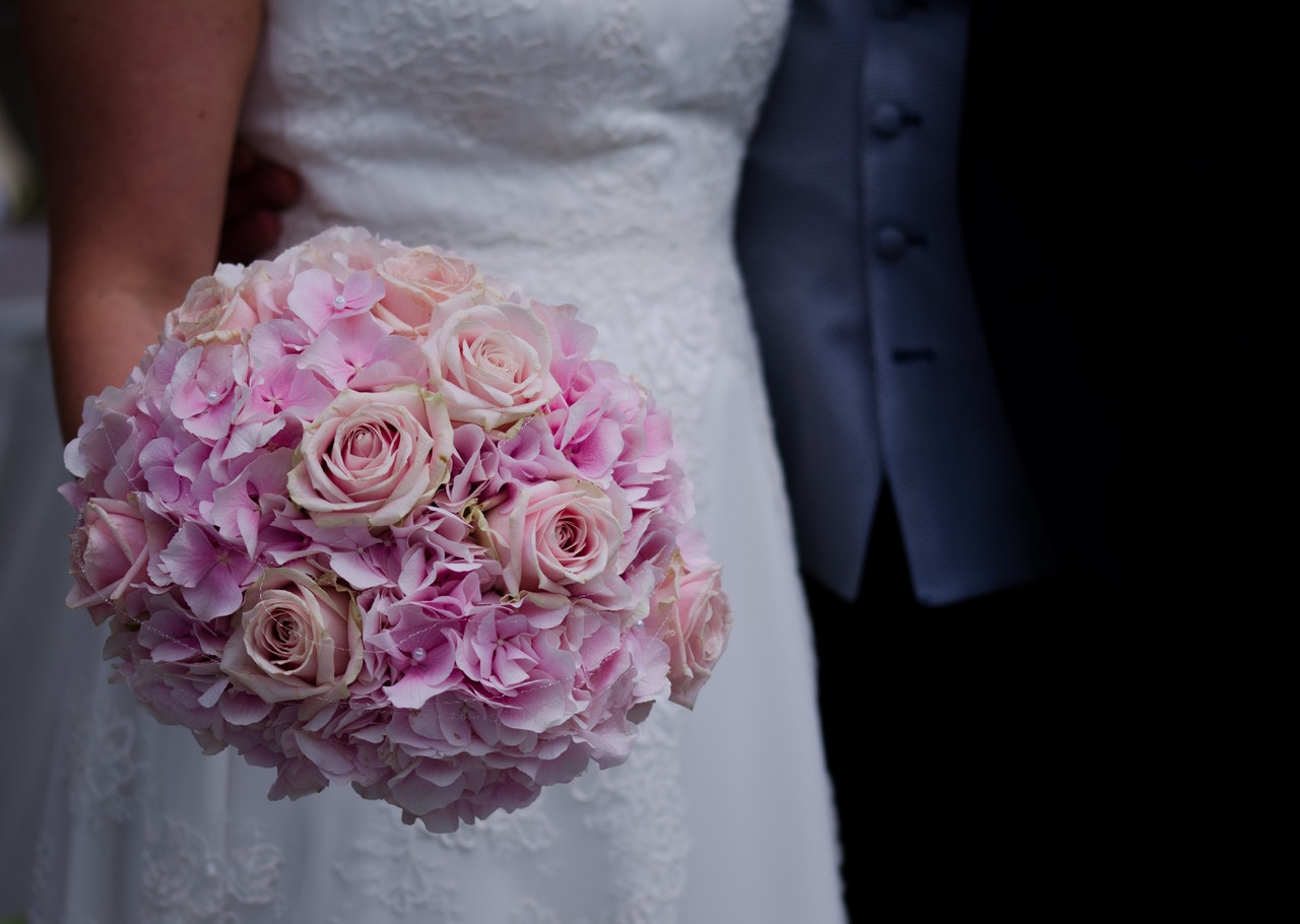 https://www.pexels.com/photo/woman-in-white-wedding-dress-holding-a-bouquet-of-flowers-160803/