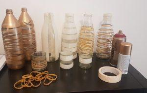 Bouteilles en verre peintes à la bombe dorée